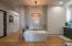 Soak your day away in this inviting and luxurious master bathroom