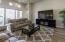 Bright open living room w/hardwood flooring.