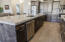 Kitchen w/upgraded cabinets, appliances, granite countertops and hardwood floors.