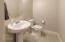 1/2 bathroom w/upgraded tile.