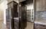 Large pantry w/hidden cabinet door.