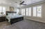 Master bedroom with plantation shutters and upgraded ceiling fan with remote.