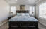 Master bedroom with plantation shutters.