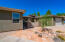 Entry from long driveway to detached casita.
