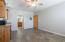 Looking from front wall back towards open living space/kitchenette/bathroom/front door.