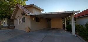 Street view; carport w/shed & extra parking