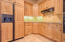Kitchen with cabinet front refrigerator