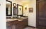 Master bath: Knotty alder cabinets, dual vanities, separate walk-in tile shower, jacuzzi tub and large walk-in closet.