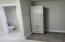 Cabinet in master bath closet area.