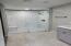 HUGE custom tiled shower, bench, 2 faucets, 1 raindrip!