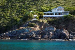 Waterfront on St. John's south shore, private villa with swimming coves on two sides is only minutes to Cruz Bay.