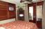 Guest Bedroom Doors Open onto Kitchen Porch Area