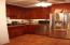 main kitchen with granite counters, cherry cabinets and ss appliances