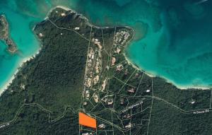 Located in the gated Peter Bay Community, this large parcel is a must see.