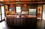 Kitchen with custom built black walnut cabinets granite counter tops and back splash