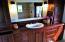 Master bathroom with black walnut cabinets
