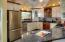 gourmet kitchen with granite counters & SS appliances