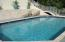 30 X 17 ft concrete/tile pool bordered by cut coral tile and new decking.