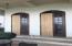 Doors to covered veranda need replacing.