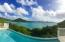 Upper level pool deck with views of Coral Bay harbor, East End and the BVI's