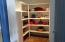 Large walk-in pantry with plenty of storage space.
