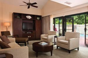 Living room of 3bd Virgin Grand unit that opens to private courtyard and pool.