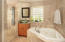 Spacious master bath with oversize hi tech shower and Jacuzzi tub