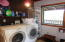 Washer & dryer area located in bathroom