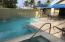 Private courtyard containing pool, spa, dining, grilling. Photo of actual unit 4314.