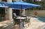 Poolside dining under the umbrella in Unit 4314.