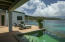 Infinity-edge pool with an incredible view of Long Bay and the Caribbean sea beyond