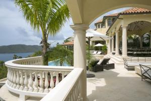 Abundant outdoor living areas include the pool deck, and two very large Verandas