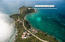 The Crown Jewel of Ditleff Point. 2.44 acres, knoll top to beachfront