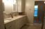 Master bath with dual sinks and large walk in shower