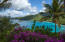 Sweeping views of Jost Van Dyke, Tortola and turquoise waters, verdant hillside.
