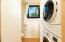 Half Bath with en suite laundry