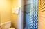 Tiled shower in loft bathroom