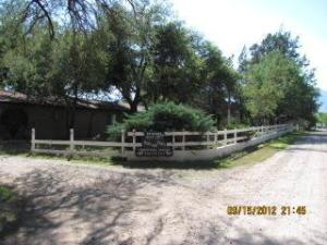 Famous River Run Boarding Facility on 8.85 Verde Riverfront Acres. 500 Feet of Verde River Frontage. Quiet Dead End Street. Complete Turn Key Business with 17 Boarded Horses. Magnificent Views of the Mountains. Heated Swimming Pool. Laser Leveled Pastures with Underground Sprinkler Irrigation. Grandfathered Water Irrigation Rights 54.5 Ac.Ft. from 2 High Producing Wells, Documented from 1894. 30 Mare motels with 20x40, 30x30, and 30x40 Runs. Huge 50x120 Turnouts. Regulation Size Dressage Arena. Wash Area. Low Sodium Night Lighting. Individual Tack Lockers. Large Parking Lot for Clients and Trailers. Home is a Comfy and Cozy Ranch Style covered by Huge Trees and Green Grass. Split Floorplan, 3 bedrooms 2 baths. Ceramic Tile Counters in the Kitchen and B... (see supplement for full remarks)