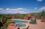 Saltwater pool, 8 person spa, wood burning kiva fireplace, outdoor speakers....