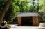Single covered carport, guest house behind