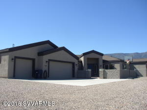 Looking for  new quality custom home. Just move in & unpack for the growing family, 4 bed (potential 5) 3 baths, 3130 sq ft.4 car garage.RV pkg & room for all the toys, on 1.12 Acre,close to everything.Has well. Fenced backyard, grass, garden & play area. Covered patio & sitting area in front Panoramic views.Wired for surround sound.Many custom upgrades, granite counters, Hickory cabinets in kitchen & bedroom. Lights under cabinets & cabinet. Custom lights, fans, quality class floors. Wide hallways. Office area with laundry & folding area.Jack & jill bedrooms w/bath & separate vanities in bdrms. Home is stucco with rolled stucco fascia. Motion lights. Citrus water softener.Home is open/great room split plan. Put this on your list to see the QUALITY. Now has leased solar!!
