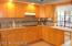 Kitchen . Cabinetry is 12 years old. Dishwasher,microwave, over, electric range, pantry