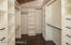 Large Walk-In Closet With Built-In Drawers and Lovely Cedar Ceiling