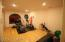 Nice Size Exercise room, with a private 1/2 Bath
