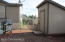 Storage shed and fenced back yard
