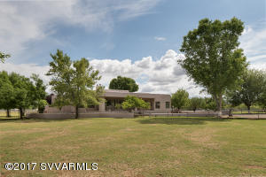 Welcome home to this exquisite 19.21 irrigated Gentleman's ranch with beautifully understated elegant home and meticulously cared for grounds. Home was completely updated in 2011 with teak floors, alder cabinets and top of the line appliances including sub-zero refrigerator, wolf cook top and double ovens. Enjoy the expansiveness of the 12' ceilings and the great room concept leading to large covered patio, an entertainers dream.  The property is every rancher's dream, 5 1.5 AC irrigated paddocks, 6 stall horse barn with 3/4 bath, enclosed hayshed, chicken coop, 90'X170' Red River roping arena with chute and return 70 ft round pen, and fronts the Verde River.  There is a separate RV hook up for guests. The beautiful grounds include Pecan, Almond, pistachio and peach trees. See attached doc