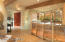 Kitchen Off Great Room With Lit Cabinetry For Collectibles