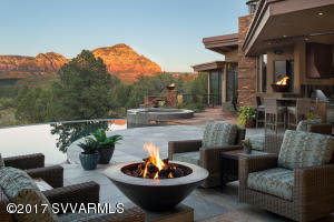 This organically sophisticated sanctuary is sure to indulge your senses; unmatched in quality and luxurious appointments inside and out. Property is surrounded by dramatic red rock serenity, situated against national forest. Golf Membership to Seven Canyons negotiable in purchase.Main residence offers 5,722-SqFt., living space and fully appointed 580-SqFt casita for guests. Designed and built in 2012 by Eric Brandt, Rick and Randy Morris. Green living with geo-thermal and solar.Exceptional outdoor living spaces include a negative edge pool, spa and lounge, state of the art roof top deck with outdoor movie theater, zen water features, fire-pits and more. VIDEO attached to photos. Documents & architectural renderings attached to MLS.