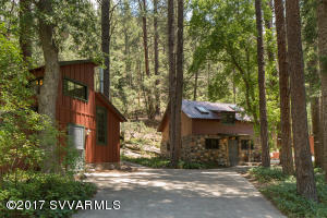A magical oasis on a rare one-acre lot in the heart of prized Oak Creek Canyon.