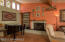 Grand Great Room with room for piano, fireplace, raised brick hearth, juniper mantle